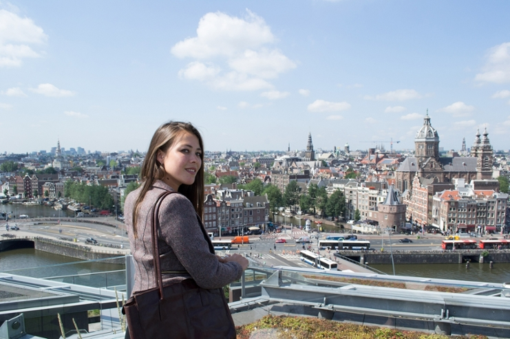 Young woman and the panorama of Amsterdam.